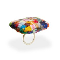 Helen Clara Hemsley. Ring: The other side of the story 2, 2016. Embroidery fabric, knitting yarn, knitting yarn stuffing and plastic ring. 5 x 5 x 3.8 cm. Photo by: James Bates Photography. Part of: Gallery O, Seoul.