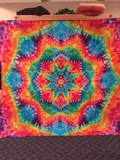 You can get this fabulous tapestry on Etsy https://www.etsy.com/listing/250833912/queen-epic-supernova-tie-dye-tapestry
