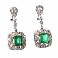 Art Deco style earrings with a pair of emerald-cut emeralds, tapered baguettes and round-facetd diaonds are handcrafted in solid 18K white gold with a touch of yellow gold applied to the emerald settings.  | Dover Jewelry