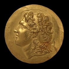 The obverse shows the diademed head of Alexander the Great (r. 336-323 BC). This posthumous and idealized portrait includes symbols of Alexander's deification, one of which is the ram's horn, characteristic of the Egyptian god Amon. This iconography derives from the type of coin introduced by one of Alexander's immediate successors, King Lysimachos of Thrace …