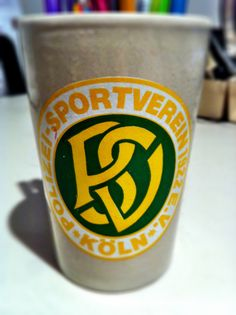 """So I bought this mug for 50 cents a number of years back and it has been very faithful to hold my pens. It looked cool. I was curious what the logo was for and found that it is for a police flying club in Colonge, Germany. The logo """"Polizeisportverein Köln 1922 e.V."""" reads """"Police Sports Club Cologne"""" in English. Pretty cool eh?"""