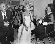 On the set of To Catch a Thief with director Alfred Hitchcock and his wife, Alma Reville, in 1954.   - ELLE.com