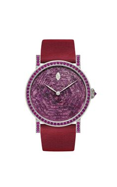 DeLaneau's Rondo Ruby Heart automatic watch in white gold, set with rubies and diamonds.