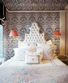 zebra print mixed with floral linens.