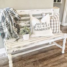 Loving this farmhouse entry! The two pillows are adorable!