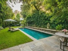 From Celine Dion to the Kardashians, dive into these Hollywood stars' out-of-this-world swimming pools.