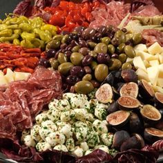 """Antipasto means """"before the meal,"""" and this antipasto recipe doesn't disappoint. Serve up this antipasto of cured meats, fresh cheeses, and herbs that will satisfy guests until the next course is ready. Antipasto Recipes, Antipasto Platter, Appetizer Recipes, Recipes Dinner, Snacks Für Party, Appetizers For Party, Christmas Eve Appetizers, Party Trays, Tapas"""