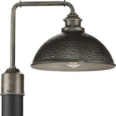 The Englewood - Outdoor Light by Progress Lighting allows you to relax and enjoy an evening basking in the light of the Englewood one-light post lantern in any outdoor space. The fixture's striking, hammered Antique Pewter shade is accented by a metallic inner shade. The structure's pipe-like arm gives it an added rustic appeal, making it an excellent choice for farmhouse and rustic exteriors. Visit PatioProductsUSA.com to purchase now! #progresslighting #outdoorlighting #patiolighting Rustic Lighting, Outdoor Lighting, Porch Lighting, Landscape Lighting, Outdoor Decor, Joss And Main, Copper Interior, Rustic Exterior, Outdoor Post Lights