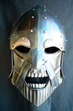 From the Hammered Wambat -  Steve Belden.  I really love this guys work. Wearable sculpture, these are functional Helms.  TB