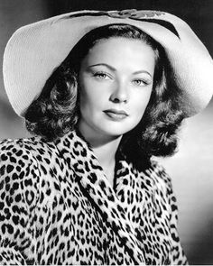 "Gene Tierney in a film still from ""Laura"", wearing a leopard coat and a ""Spaniel's Ears"" hat of Bonnie Cashin's design, 1944. Love it."