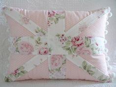 Shabby Chic Rachel Ashwell Wildflower fabric Union Jack Cushion Pillow with pom pom trim. $38.00, via Etsy.