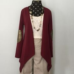 Just In❣Glitter Patch Cardigan Cute little Cardigan has pointed hemline and Glitter Patches at elbows. Made of soft Jersey Knit in a beautiful Burgundy color. Lightweight enough for Spring but works well in colder temps layered over long sleeve shirt or Henley. Will best fit a size S to M. *(tag cut out because it irritated neck). Worn only a couple times and in EUC. Sweaters Cardigans