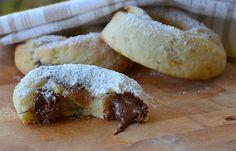 Le ciambelline alla Nutella sono un dolce ideale per la prima colazione, soffici, golose e ripiene di Nutella! Cosa c'è di meglio?