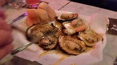 Acme oyster house.  Must go! Chargrilled oysters.  Had 6 Chargrilled 18 raw oysters gumbo red beans rice and chorizo sausage.  I liked their hurricane better than pat obrien's.