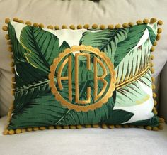 A personal favorite from my Etsy shop https://www.etsy.com/listing/279264344/monogrammed-banana-leaf-pillow