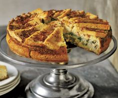 Elegant eggs, served in this savory charlotte, begin with Fontina and ricotta cheeses, fresh basil and parsley, and thin slices of bread. The result is a melt-in-your-mouth brunch dish.  Recipe: Fontina and Herb Charlotte   - CountryLiving.com