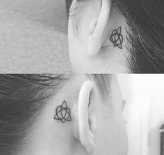 Celtic knot of sisterhood tattoo behind ear