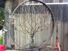 """Giant oak tree with swing.  Diameter measures 44"""".  Made from recycled wagon wheel and steel.  See my other works on Facebook  Art O Sphere.  All items available for sale.  This piece is an extraordinary value at $400."""
