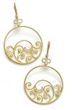 Leslie Greene 18k gold and diamond earrings.