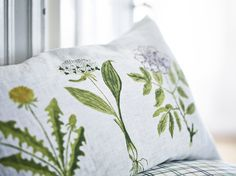 Decorated with delicate wildflower illustrations, brighten your bedding with a DORTHY cushion cover. #IKEA #botanicals