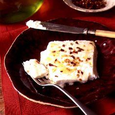 Baked Feta Recipe - Saveur.com - Istead of FALMMING feta - cuz sometimes...simple is good!