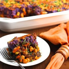 Vegetarian Shepard's pie, loaded with mushrooms, chickpeas, & veggies. Topped with purple, buttermilk mashed potatoes.