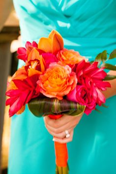 tropical bridesmaid bouquet orange chile roses,  kiko fuschia roses, red ginger, cymbidium orchids