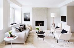 """7 Design """"Mistakes"""" That Are Actually Totally Chic//Modern white living room with cowhide rug"""