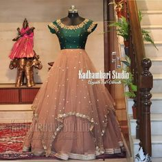 Stunning blush pink color traditional floor length dress with floral print. Dress with big gold jari boarder. Floor length dress with net dupatta. This outfit is Available at 8000 from house of Kadhambari. They can customize size as per your requirement. Indian Gowns Dresses, Indian Fashion Dresses, Indian Designer Outfits, Indian Outfits, Designer Anarkali Dresses, Designer Dresses, Designer Wear, Long Gown Design, Half Saree Designs