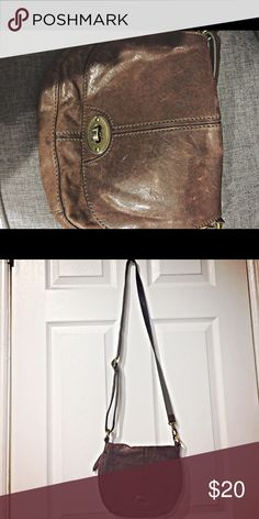 Fossil Crossbody Bag 🦄 Crossbody Leather Fossil Bag. Leather is distressed and softened but bag is in good condition. Strap is adjustable. Perfect size for a lady on the go who doesn't want to carry too much with her! Bags Crossbody Bags