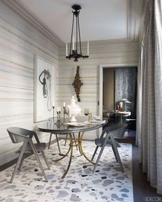 Dining chairs by Jacques Adnet in Jean-Louis Deniot's Paris apartment.