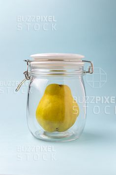 Quince ripe in the jar for conservation over blue background. Photography For Sale, Blue Backgrounds, Conservation, Jar, Decor, Decorating, Jars, Decoration, Inredning