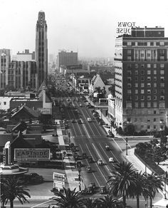 Westward view of Wilshire Blvd as seen from Commonwealth. The drive-in restaurant Simon's Sandwiches is at the lower left, the Town House Hotel is opposite, and down the street is the Bullock's Wilshire tower.