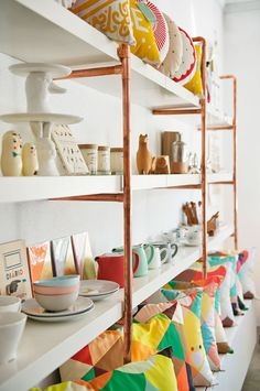 Copper pipe shelving.
