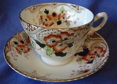 Hand Colored Tansferware cup and saucer.