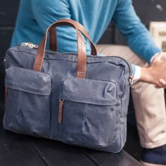 Tommy Work Bag, indigo coloured waxed coated canvas outer and a 15 inch laptop bag by Property Of...