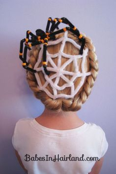 If your daughter has a bit of a mischievous side, she'll love spooking her friends with this creepy crawly updo. Get the tutorial at Babes In Hairland.
