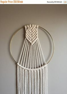 This is a slight variation of my Chevron Arrowhead Macramé Dreamcatcher design. The Arrowhead is longer but the length of the entire piece is slightly shorter. The ring measures 12 and the entire length is 43. The design is simple yet interesting. A versatile piece that will fit in with Boho Hippie/Bohemian/Eclectic Decors or even Minimalist and Rustic Modern. This item is ready to ship! Please convo me with any questions. I welcome custom orders! Copyright 2016 Moonshadow Macr...