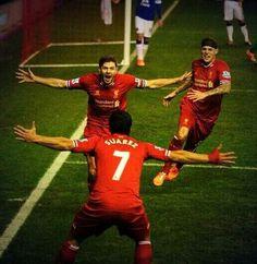 Steven Gerrard celebrating his goal vs Everton last season with Luis Suarez and Martin Skrtel