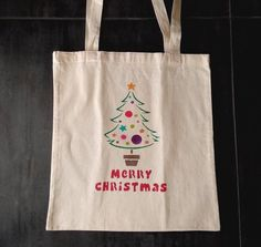 Christmas tree tote bag, handpainted handcrafted bag, natural cotton bag colourfull design shopping bag, fashion, ideal gift. Christmas Tree Canvas, Christmas Gifts, Plastic Shopping Bags, Cellophane Bags, Cotton Bag, Canvas Tote Bags, Diaper Bag, Reusable Tote Bags, Hand Painted