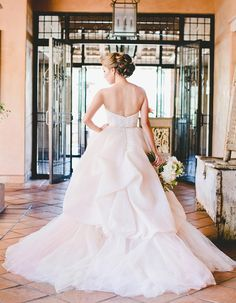 This bride rocked a gorgeous Lazaro ball gown. This unique and beautiful california wedding is a must-see. Flawlessly captured by ART IS FOR LOVERS, every detail of this romantic and rose gold-themed wedding.