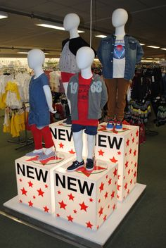 // visual merchandising // display // mannequins // childrens fashion // stars