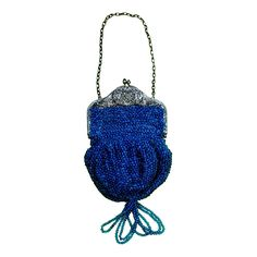 Striking Vintage 1920s Art Deco Purse Blue & Silver Beaded Tassel Flapper Bag | From a collection of rare vintage handbags and purses at https://www.1stdibs.com/fashion/accessories/handbags-purses/