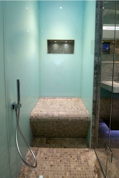 A modern - and easy to install - shower wall panel are these high gloss wall panels. They look like back painted glass but are lighter and cost less. Learn more here - http://innovatebuildingsolutions.com/products/bathrooms/high-gloss-acrylic-wall-panels