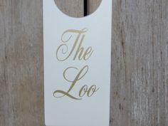 Hey, I found this really awesome Etsy listing at https://www.etsy.com/listing/469677556/the-loo-door-knob-hanger-wood-vinyl-sign