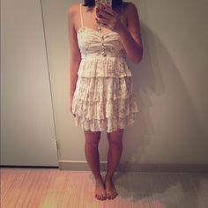 Beige floral ruffle dress Beige floral ruffle dress. Good condition with gentle wear. Very small spot as pictured in last photo. Please use offer button thanks! Forever 21 Dresses Mini