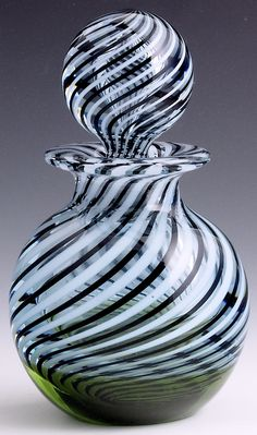 "Caithness Glass {Scotland} - Part of a large collection of Caithness paperweights collected by an employee of the company. Many rare and one-of-a-kind pieces. 3 3/8""w x 5 3/4't, 32.8 oz. - #0511"