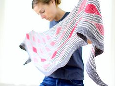 """A soothing and addictive knit -- pick your favorite yarn in your favorite colors and away you go! Simple garter stripes work up quickly with fun dashes of short row """"beads"""" -- perfectly suited for anything from fingering weight to DK."""