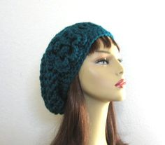 This is made to order. Please check my processing times under the shipping button before ordering.  This beanie is super slouchy. I used two strands of yarn to give an extra thick look. It is stretchy and will fit most teens or adults. It has a large enough slouch to tuck lots of hair. It is very simple but classy. This hat is made to order. If you would like a different color please specify color.  Hand wash is recommended.