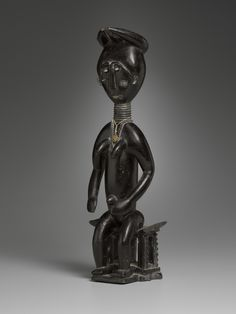 Female Figure Seated on a Stool    late 19th–early 20th century  Wood  42.55 x 12.7 x 10.16 cm (16 3/4 x 5 x 4 in.)  Charles B. Benenson, B.A. 1933, Collection  2006.51.511  Geography:   Made in Guinea Coast, Ghana  Culture:   Fante-large.jpg (1441×1920)